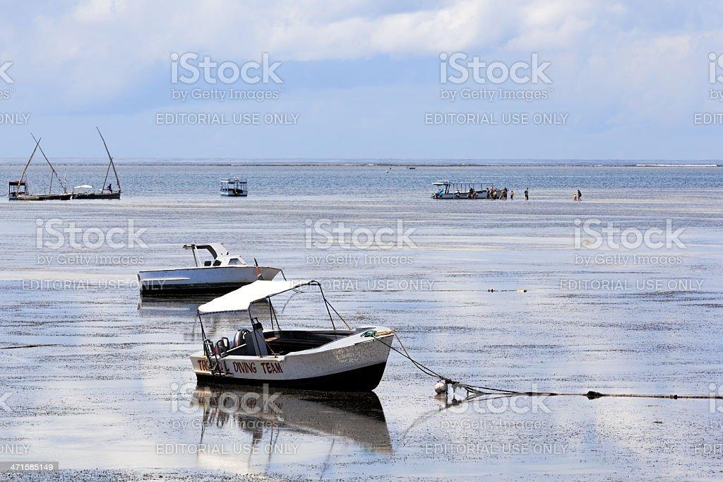 fishing boats at beach stock photo