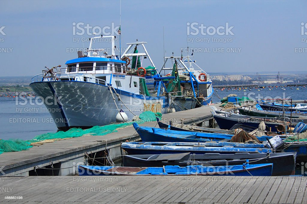 Fishing boats at dock in Taranto, Puglia, Italy. stock photo