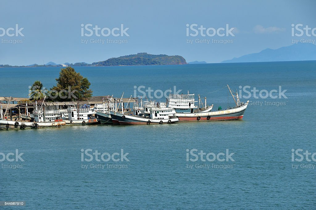 Fishing Boats at dock in Thailand stock photo