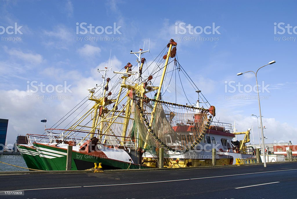 Fishing boats at harbor stock photo