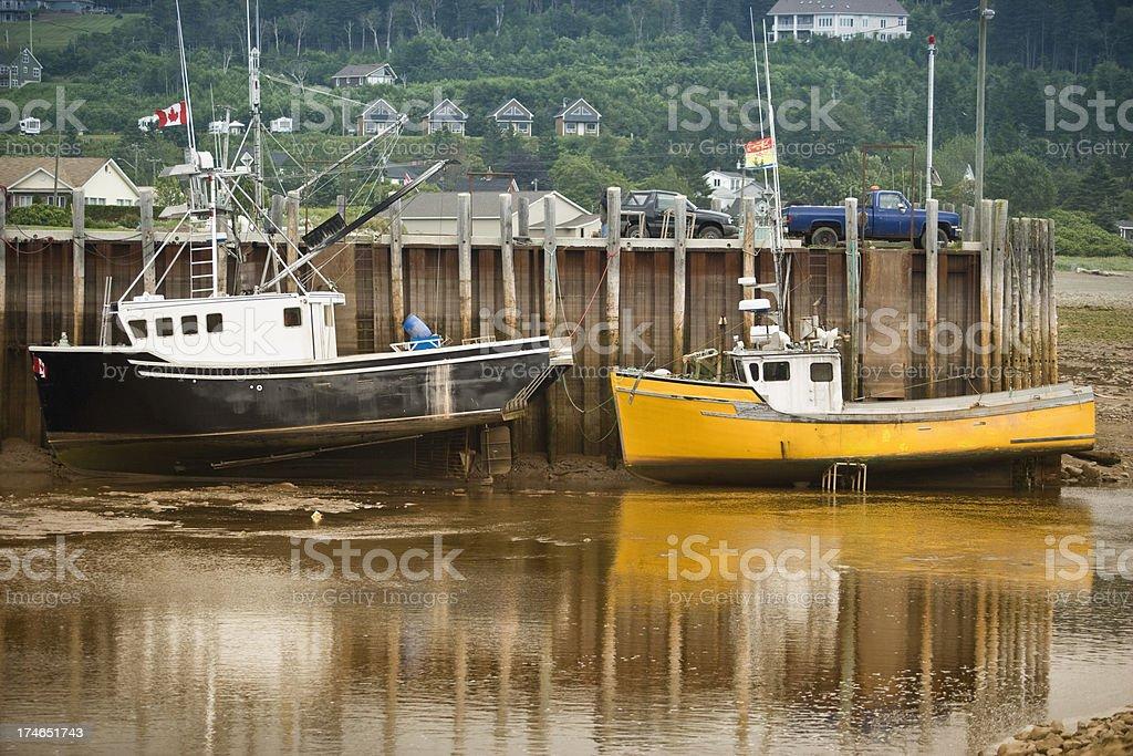 Fishing boats at low tide royalty-free stock photo