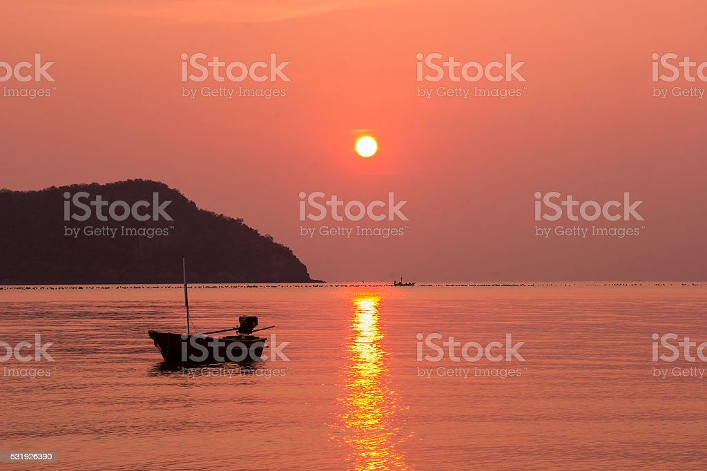Fishing boats at sea with the morning sun. stock photo