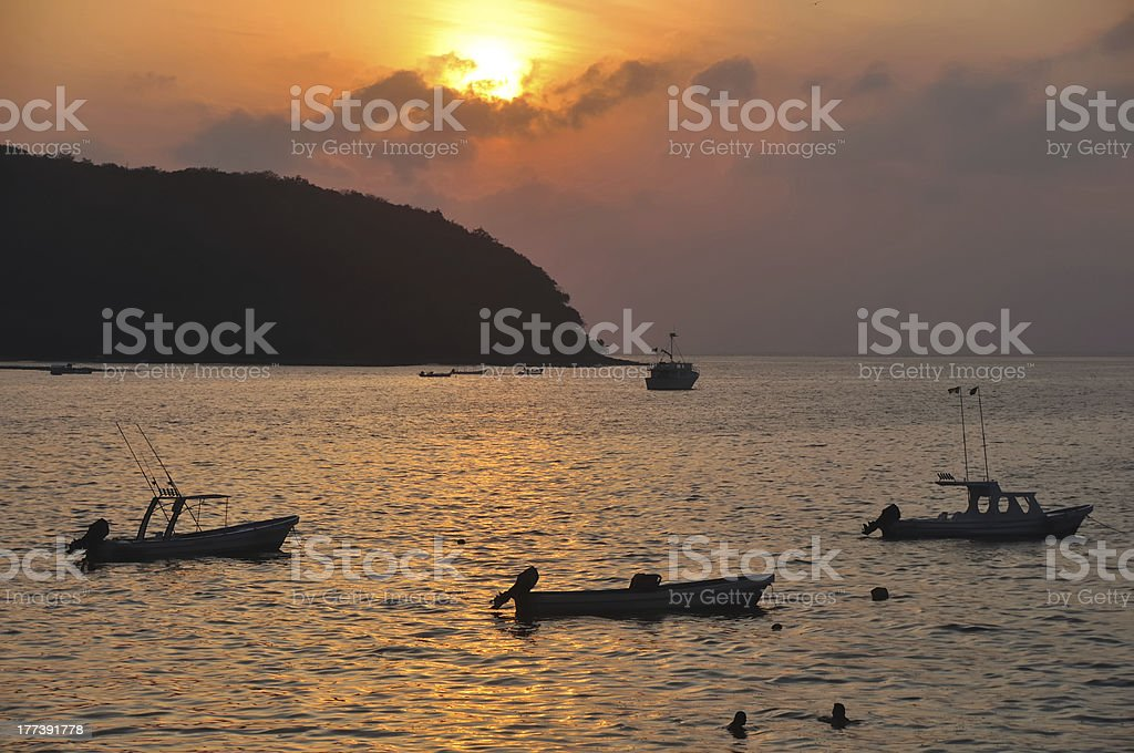 Fishing Boats At Sunset in Zihuatanejo Bay stock photo
