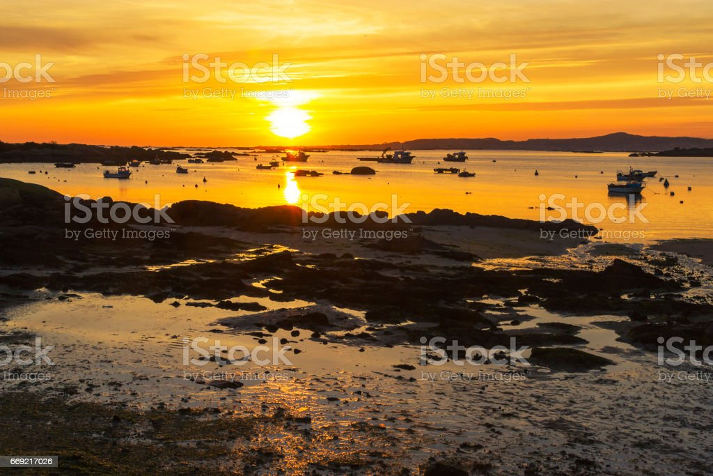Fishing boats at sunset stock photo