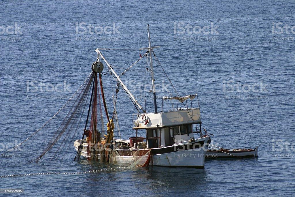 Fishing boats at work royalty-free stock photo