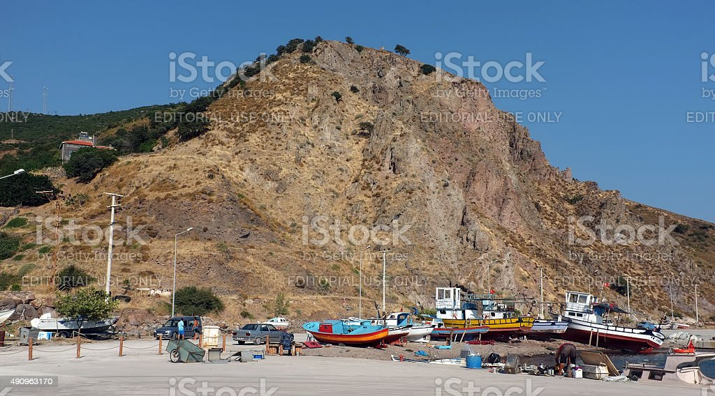 Fishing boats by the mountain stock photo