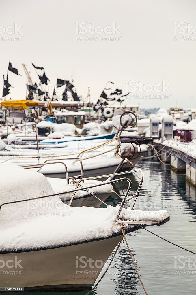 Fishing boats covered in snow royalty-free stock photo