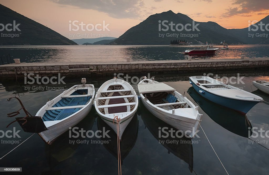 Fishing boats float moored in Perast. Montenegro royalty-free stock photo