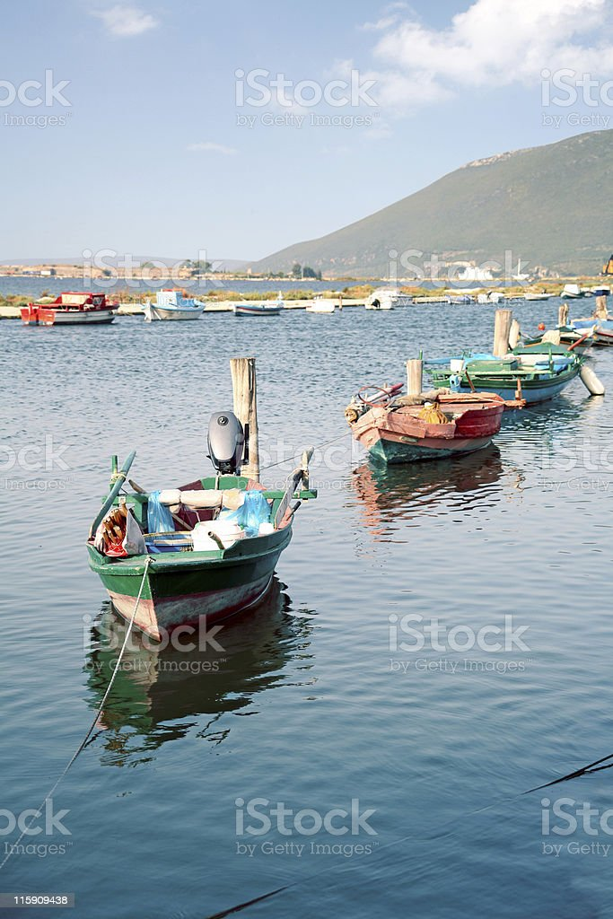 Fishing boats in a row stock photo