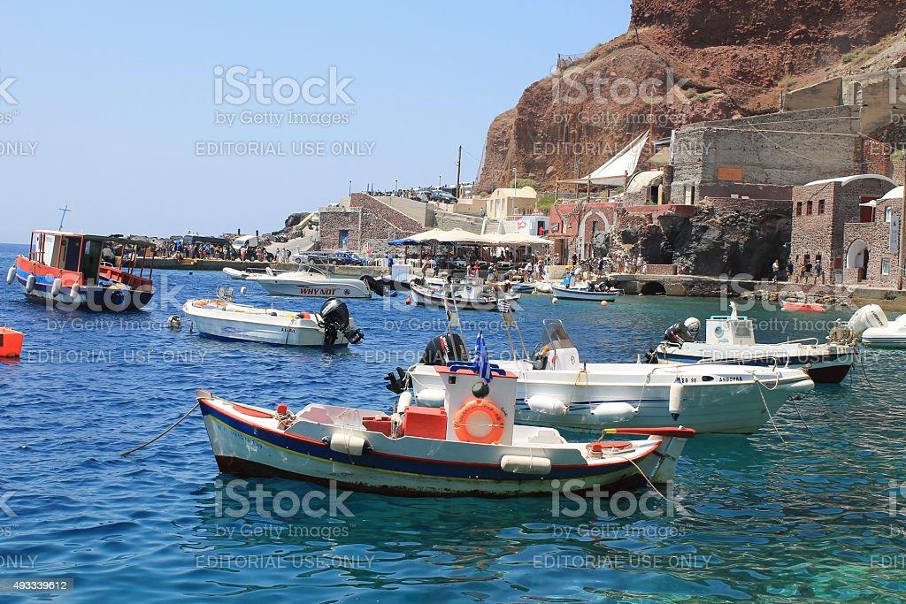 Fishing boats in Ammoudi bay, port of Oia, Santorini, Greece stock photo