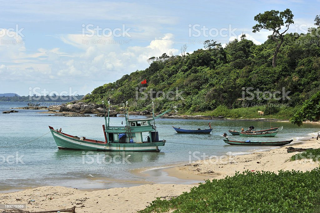Fishing boats in cove and beach stock photo