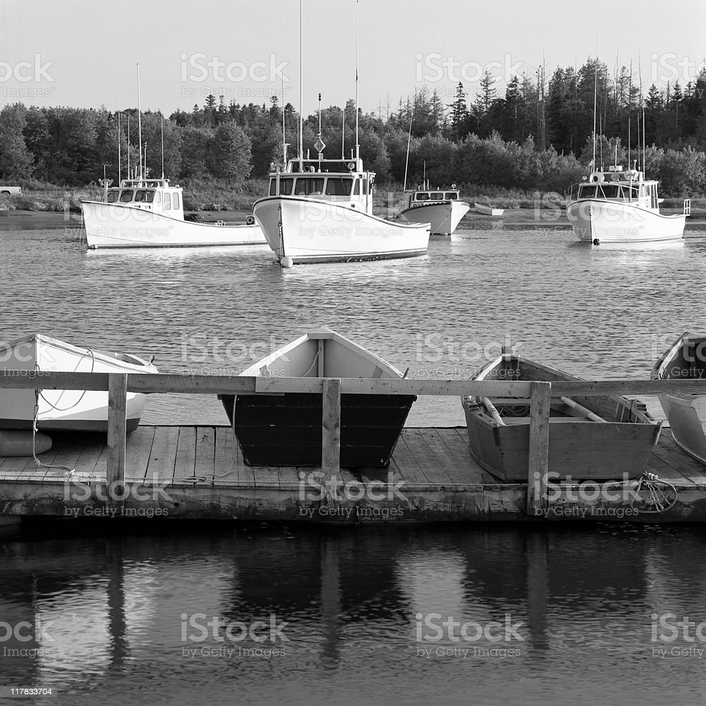 Fishing boats in harbor stock photo
