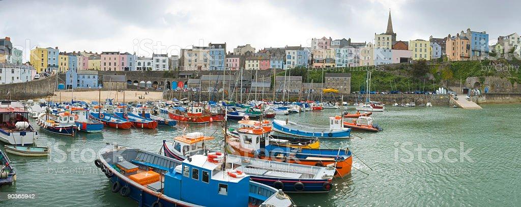 Fishing boats in harbor stock photo