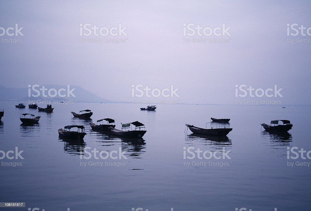 Fishing Boats in Harbour at Dawn stock photo