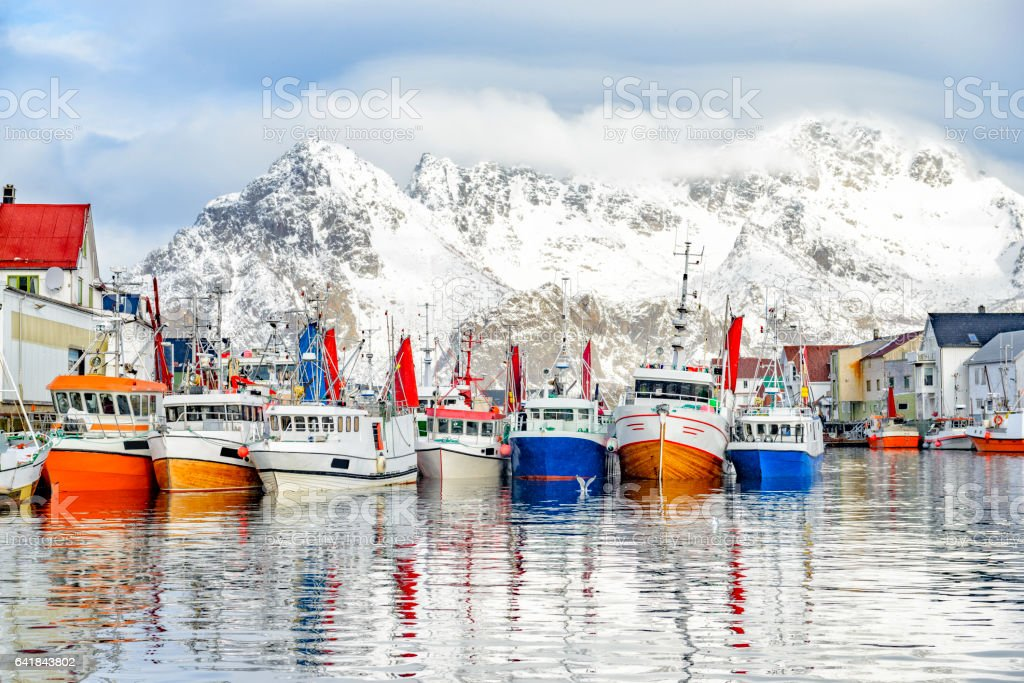 Fishing boats in Henningsvaer in winter in Lofoten archipel, Norway stock photo