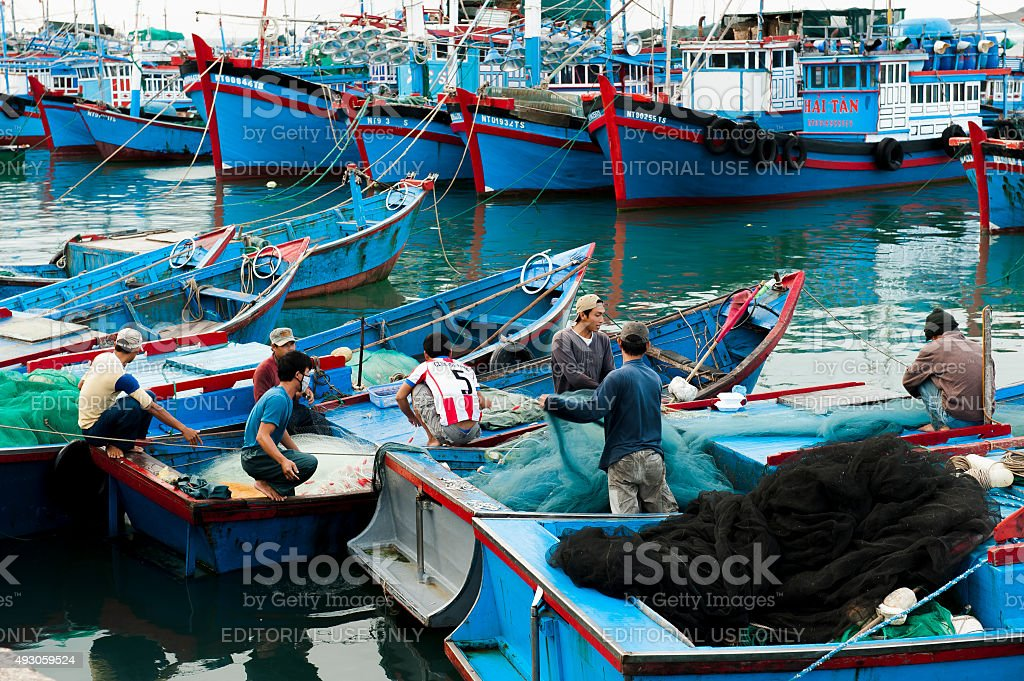 Fishing boats in port in Phan Rang, Vietnam. stock photo