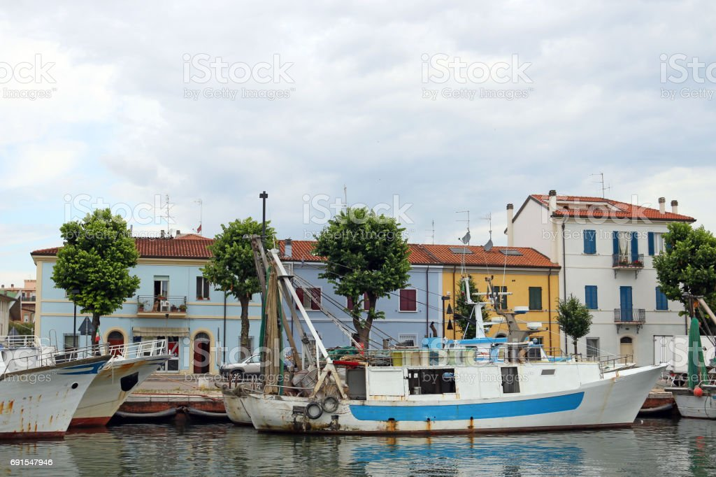 fishing boats in port Rimini Italy stock photo