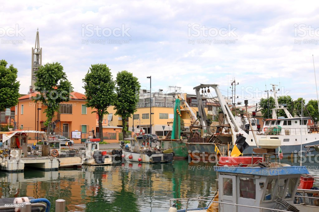 fishing boats in port Rimini Italy summer season stock photo