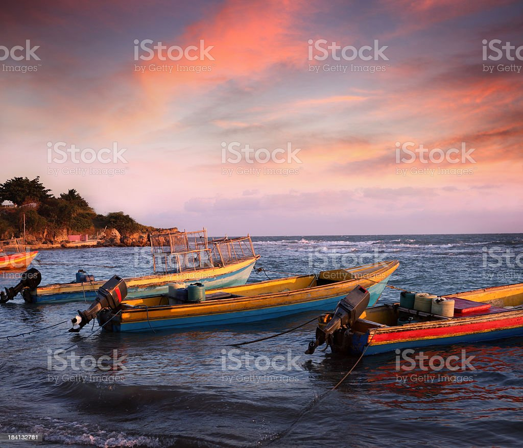 Fishing boats in sunset light stock photo