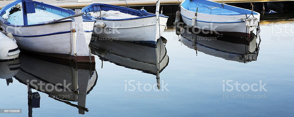 Fishing boats in the Antibes harbor royalty-free stock photo