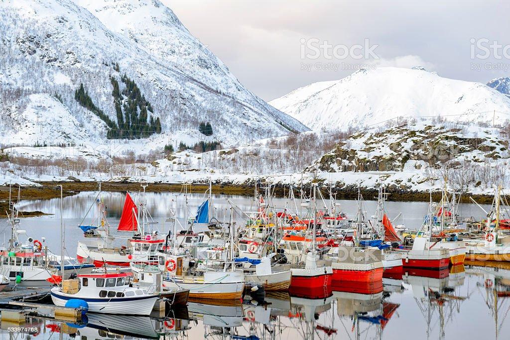 Fishing boats in the Austnesfjorden in winter in the Lofoten stock photo