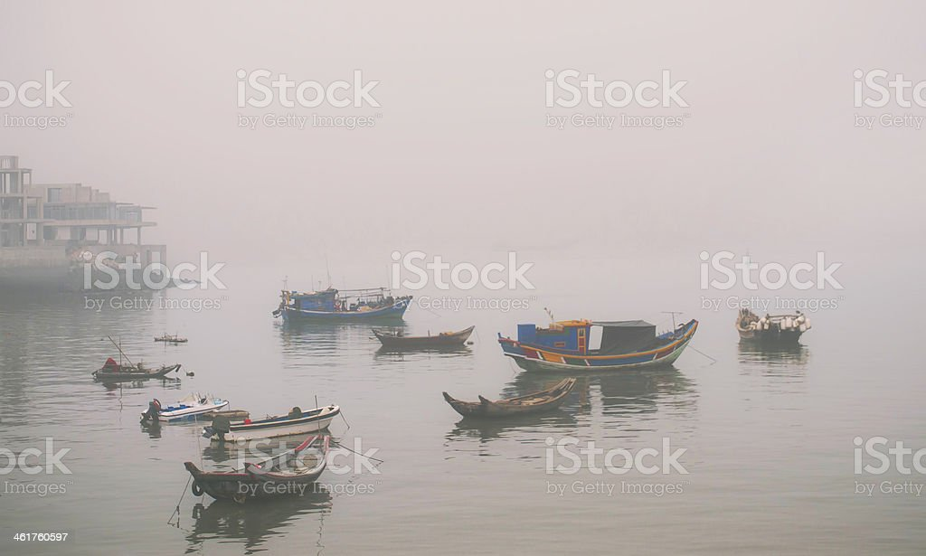 fishing boats in the fog stock photo