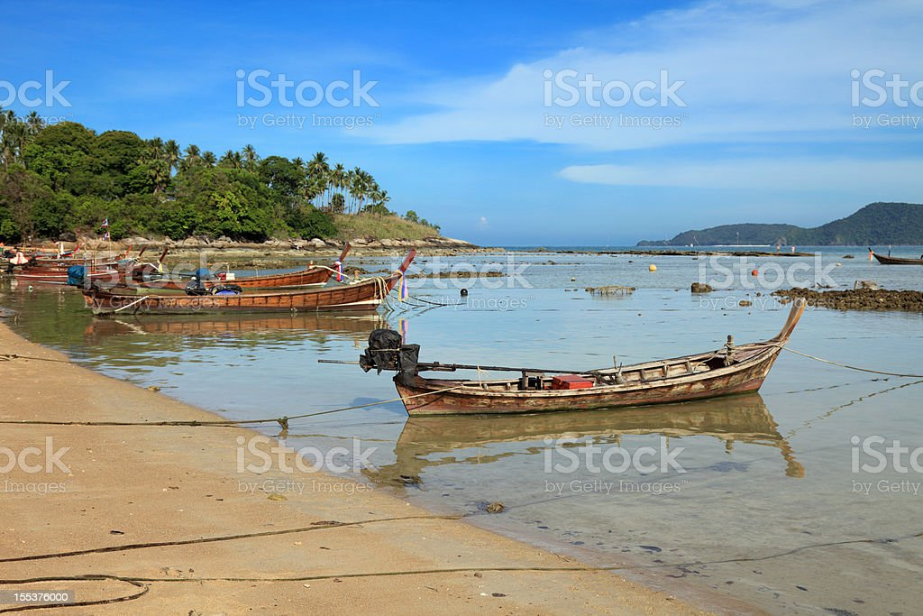 Fishing boats in the harbor near Rawai Landing Pier stock photo
