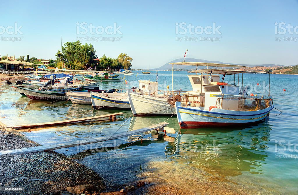 Fishing boats in the harbor of small village stock photo