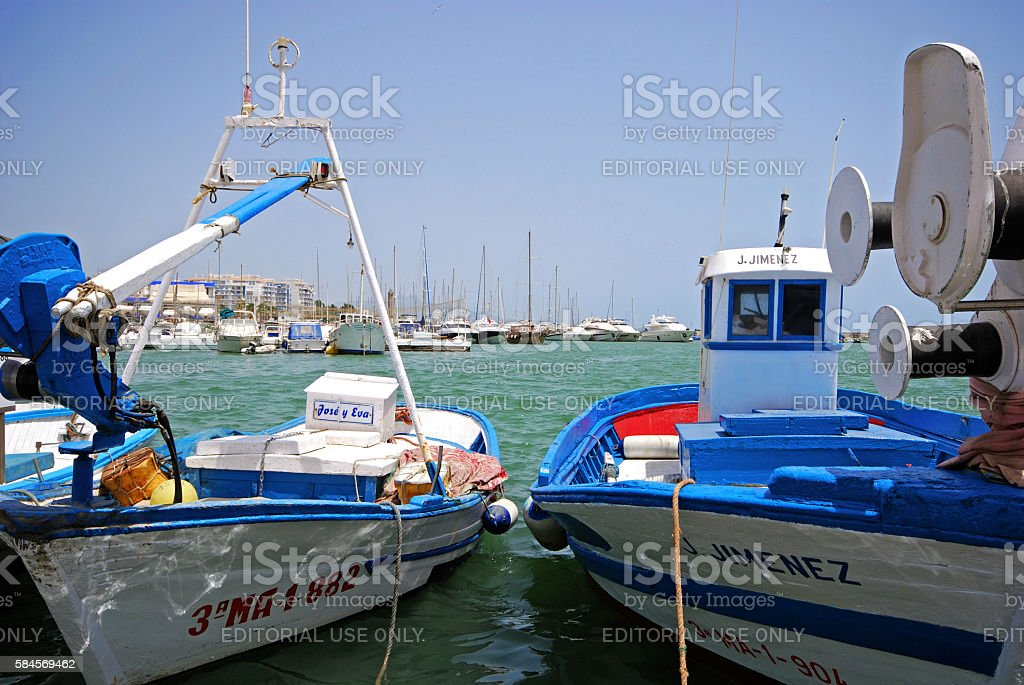 Fishing boats in the harbour, Estepona. stock photo