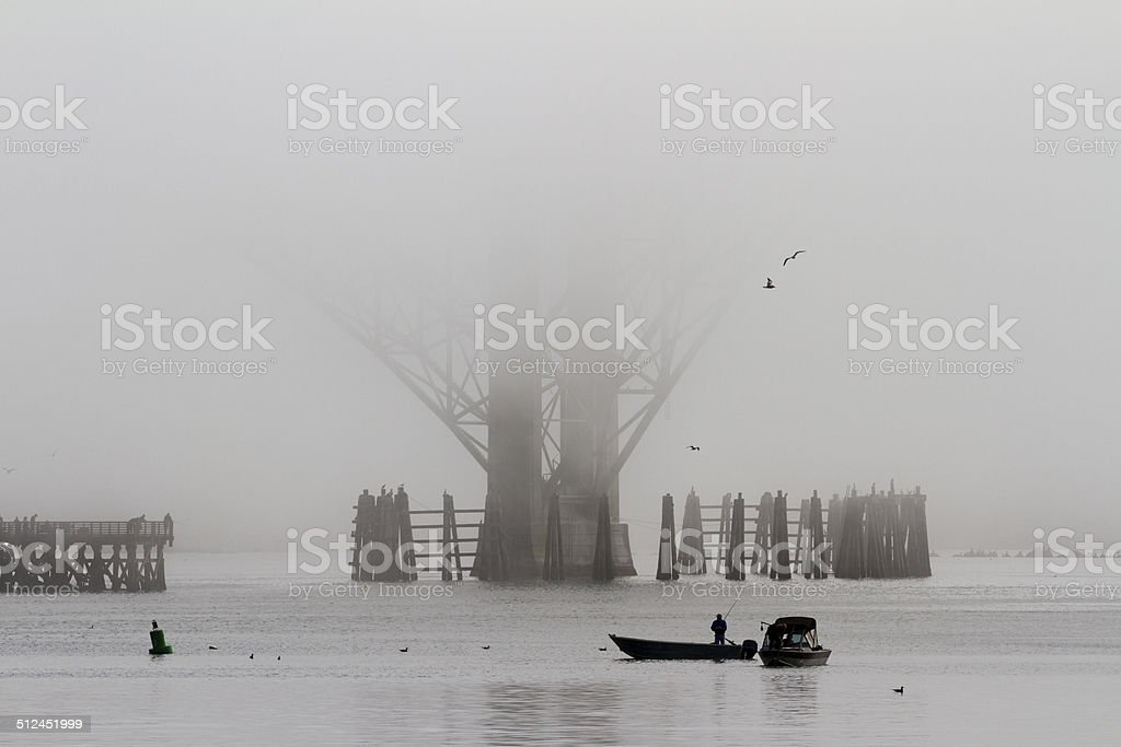 Fishing boats in the mist stock photo