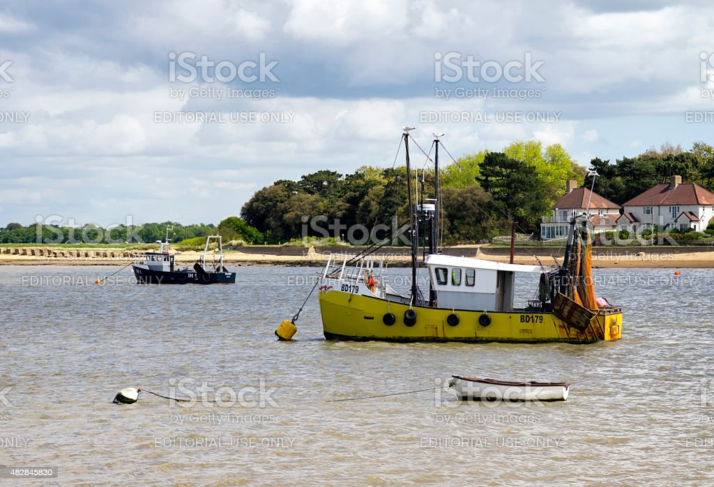 Fishing boats in the River Deben stock photo