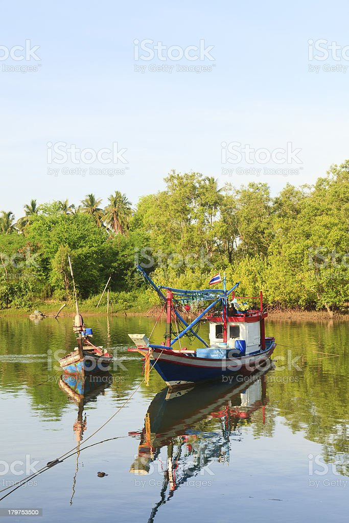 Fishing boats in the river royalty-free stock photo