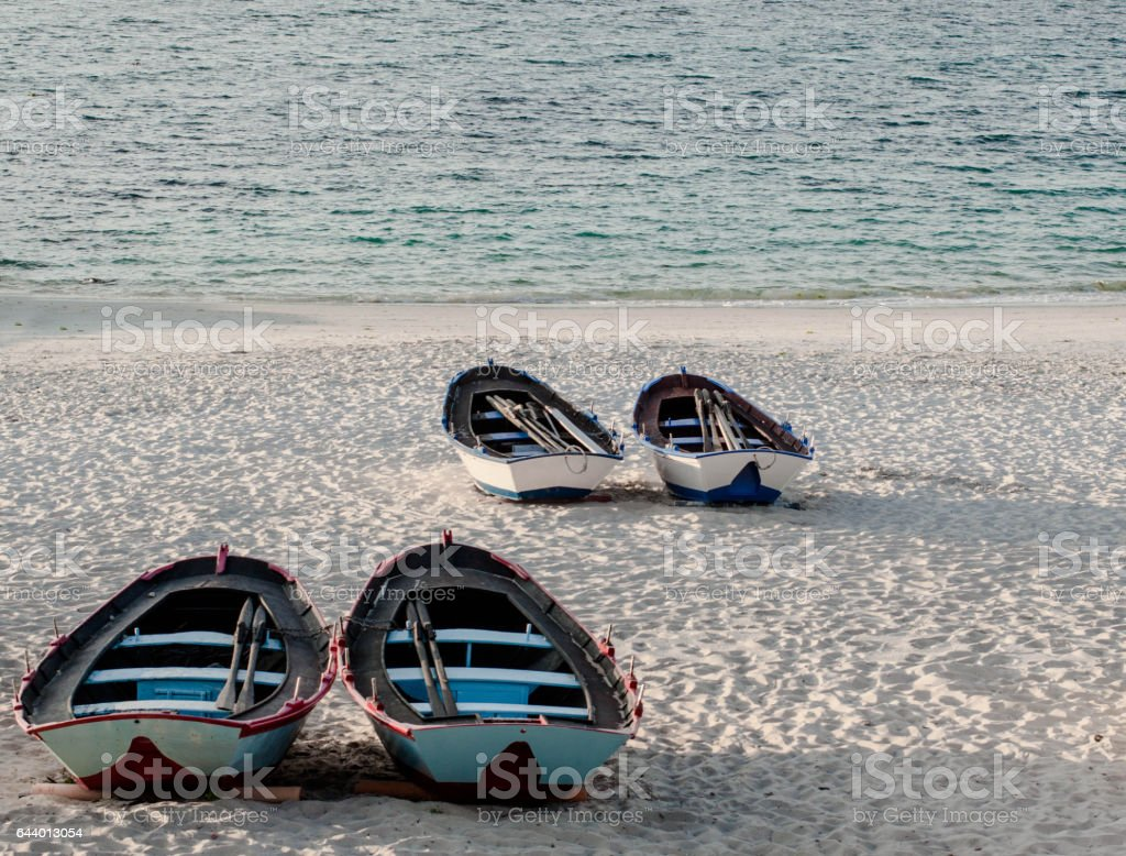 fishing boats in the sand of the beach in spain stock photo