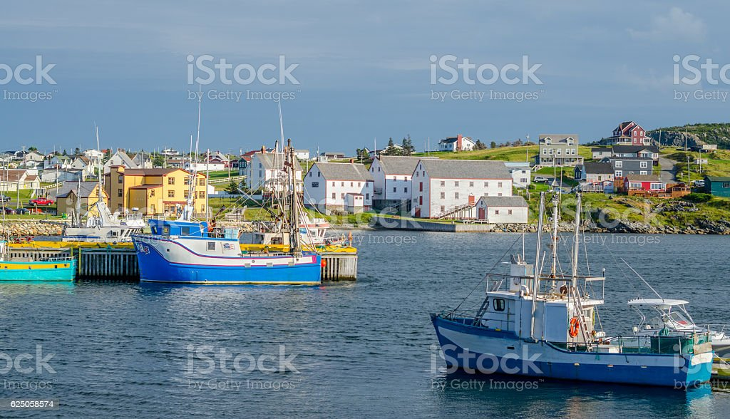 Fishing boats in the village harbour in Bona Vista, Newfoundland, Canada. stock photo