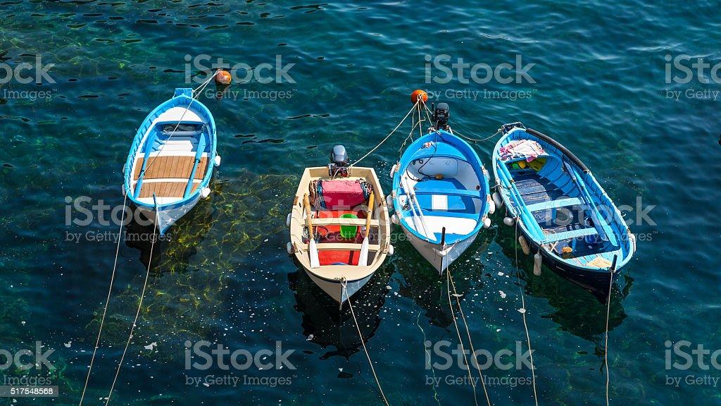 fishing boats inside the harbor of Vernazza, Cinque Terre, Italy stock photo
