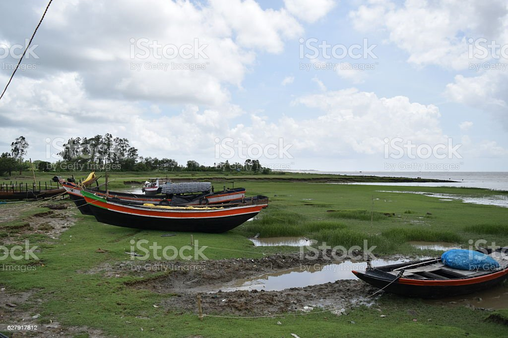 Fishing boats lying on the banks of the river Hughli. stock photo