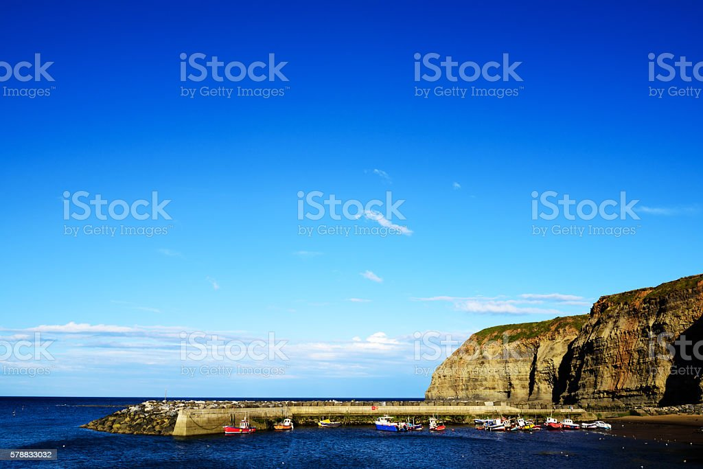 Fishing boats moored in Staithes Harbour stock photo