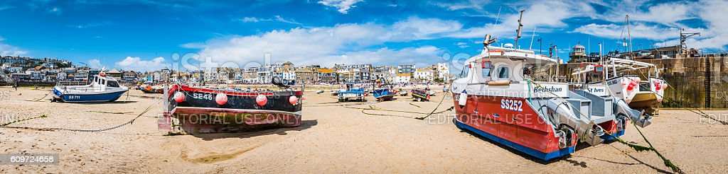 Fishing boats moored seaside beach harbour panorama St Ives Cornwall stock photo
