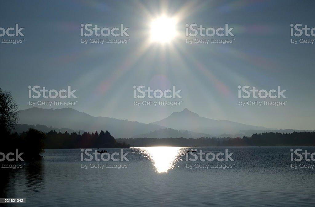 Fishing boats on a lake stock photo