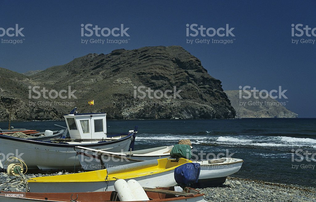 Fishing Boats on a Pebble Beach stock photo