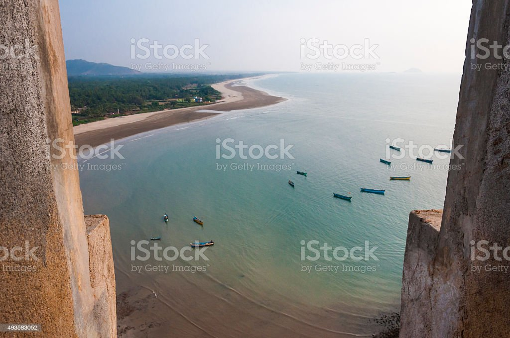 Fishing boats on Arabian sea coastline in Murudeshwar Karnataka India stock photo