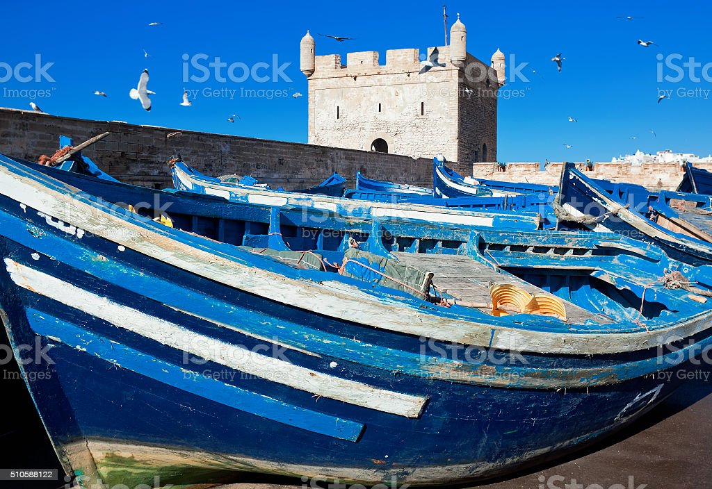 Fishing boats on background of Castelo Real of Mogador. Morocco stock photo