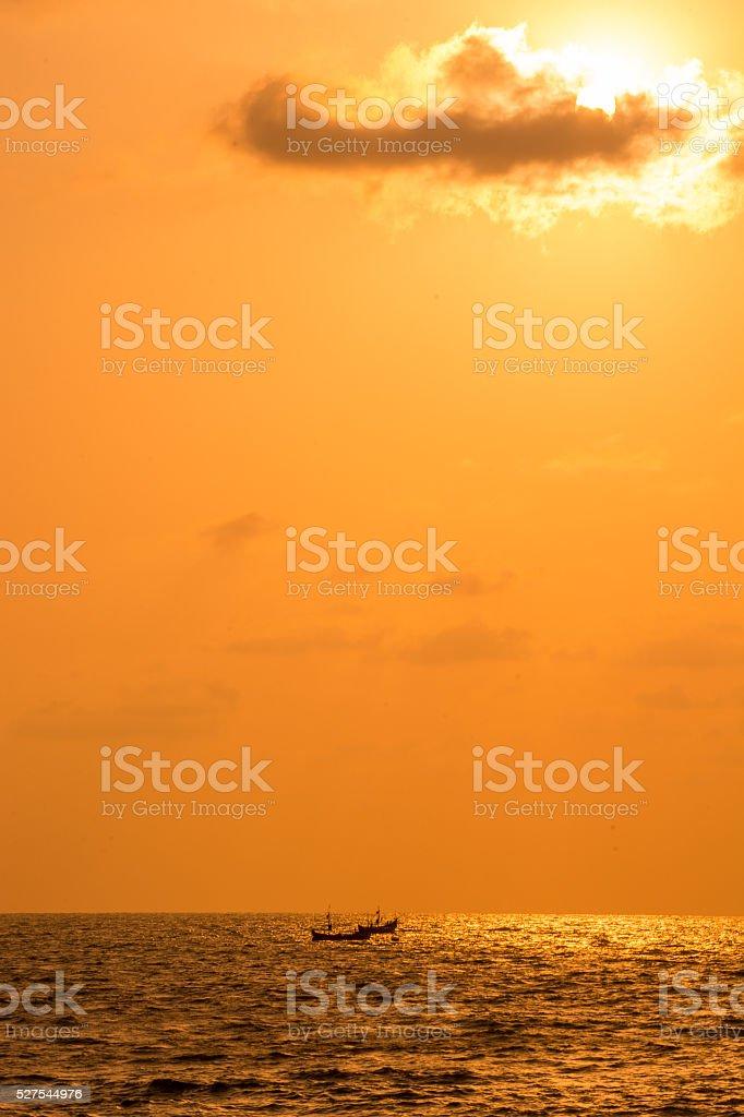Fishing Boats On Sea At Sunset stock photo