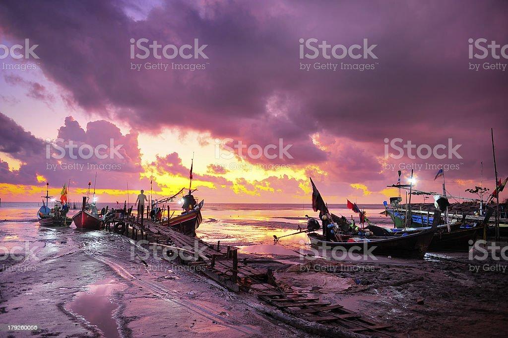 Fishing boats on sunrise background royalty-free stock photo
