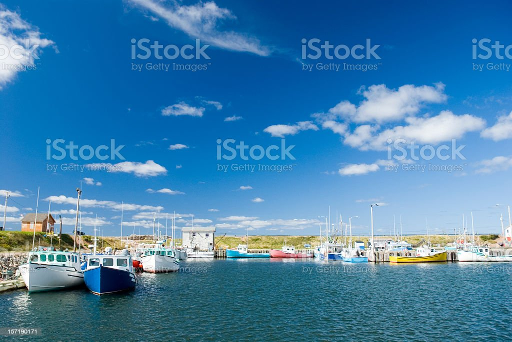 Fishing boats on the sea on a cloudy day stock photo