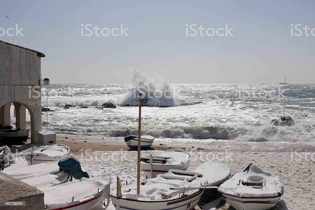 fishing boats on the snow stock photo