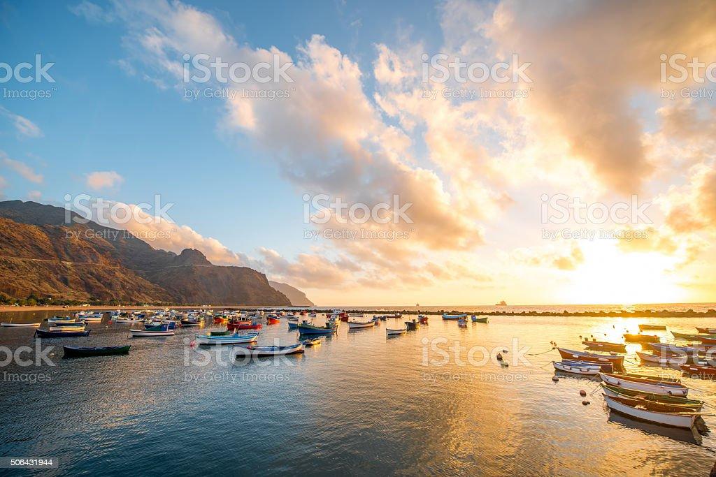 Fishing boats on the sunrise stock photo