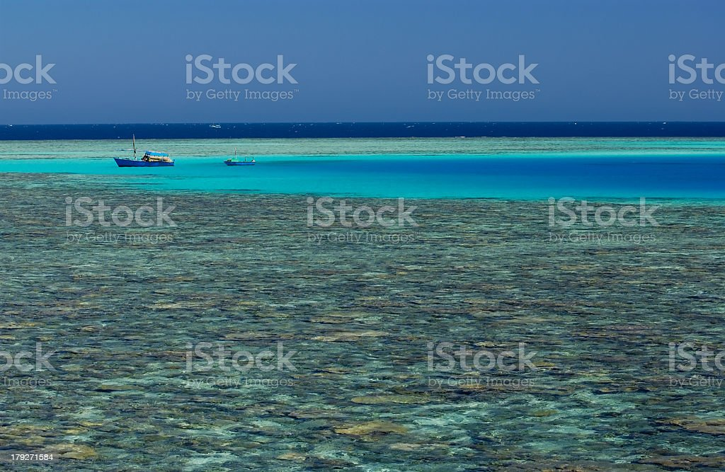 Fishing boats over the reef royalty-free stock photo