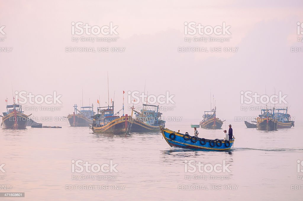 Fishing boats return to port royalty-free stock photo