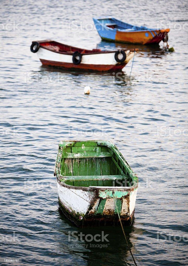 Fishing boats sitting at sea stock photo